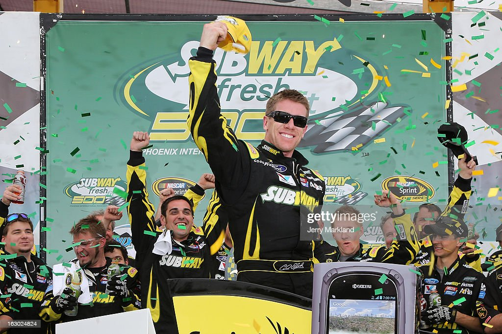 Carl Edwards driver of the Subway Ford celebrates in victory lane after winning the NASCAR Sprint Cup Series Subway Fresh Fit 500 at Phoenix...