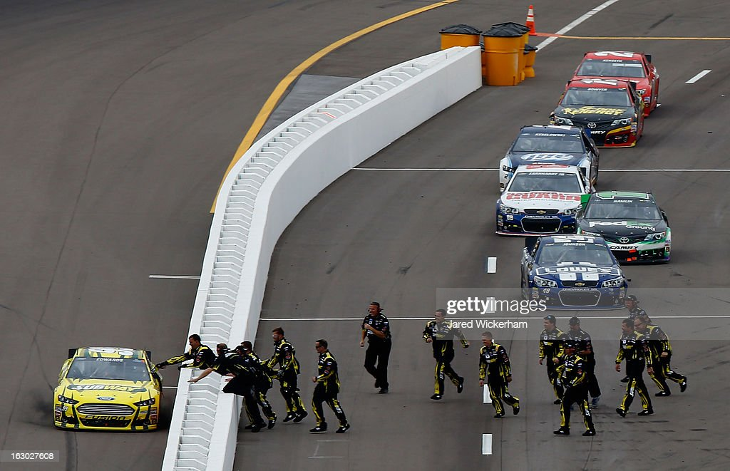 <a gi-track='captionPersonalityLinkClicked' href=/galleries/search?phrase=Carl+Edwards+-+Racecar+Driver&family=editorial&specificpeople=193803 ng-click='$event.stopPropagation()'>Carl Edwards</a>, driver of the #99 Subway Ford, celebrates with his crew after winning the NASCAR Sprint Cup Series Subway Fresh Fit 500 at Phoenix International Raceway on March 3, 2013 in Avondale, Arizona.