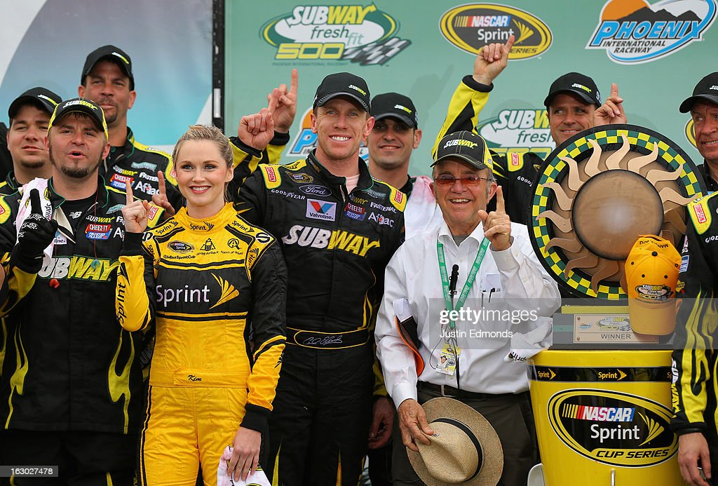 <a gi-track='captionPersonalityLinkClicked' href=/galleries/search?phrase=Carl+Edwards+-+Racecar+Driver&family=editorial&specificpeople=193803 ng-click='$event.stopPropagation()'>Carl Edwards</a>, driver of the #99 Subway Ford, celebrates with team owner <a gi-track='captionPersonalityLinkClicked' href=/galleries/search?phrase=Jack+Roush&family=editorial&specificpeople=260209 ng-click='$event.stopPropagation()'>Jack Roush</a> during the NASCAR Sprint Cup Series Subway Fresh Fit 500 at Phoenix International Raceway on March 3, 2013 in Avondale, Arizona.