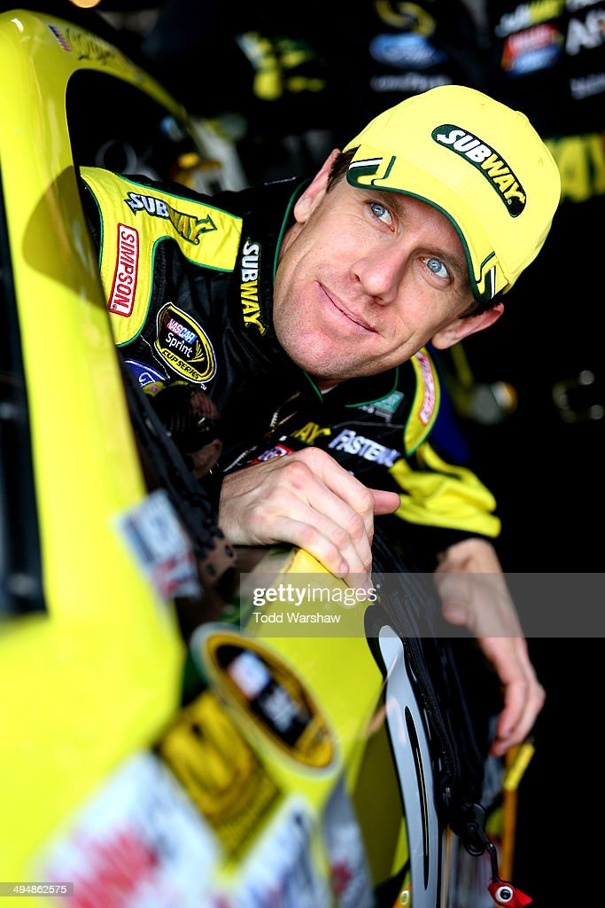 <a gi-track='captionPersonalityLinkClicked' href=/galleries/search?phrase=Carl+Edwards+-+Racecar+Driver&family=editorial&specificpeople=193803 ng-click='$event.stopPropagation()'>Carl Edwards</a>, driver of the #99 Subway Ford, climbs in his car during practice for the NASCAR Sprint Cup Series FedEx 400 Benefiting Autism Speaks at Dover International Speedway on May 31, 2014 in Dover, Delaware.
