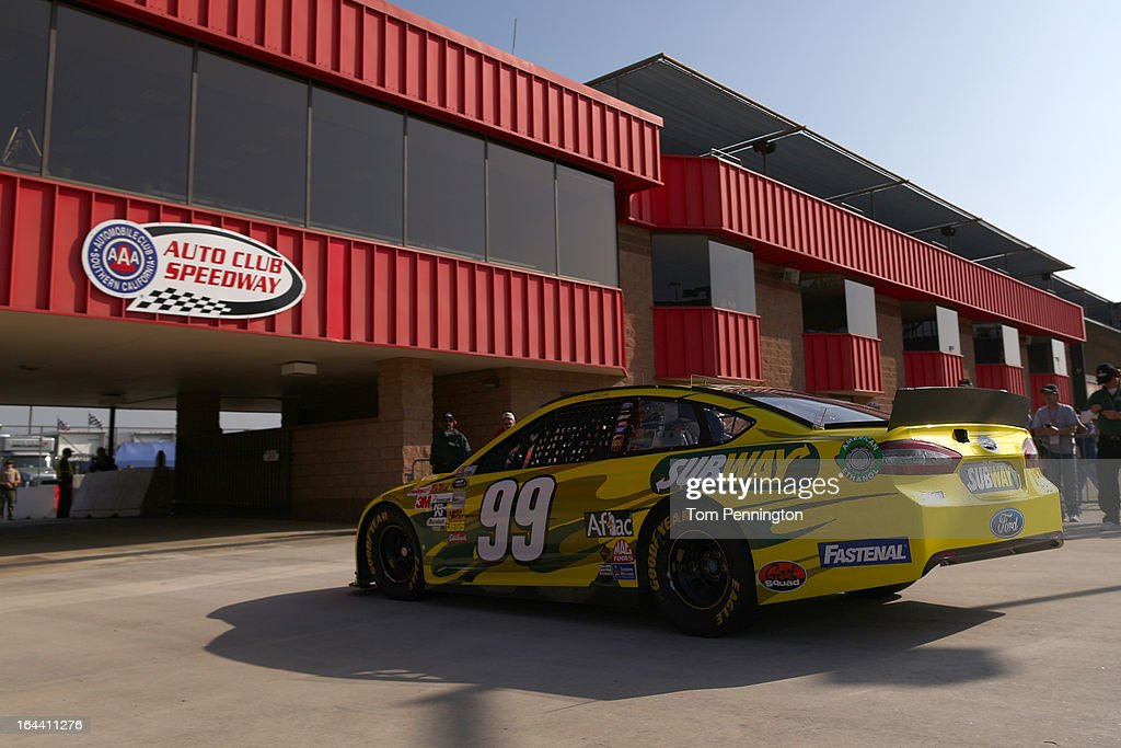 Carl Edwards, driver of the #99 Subway Ford, drives to the garage area during practice for the NASCAR Sprint Cup Series Auto Club 400 at Auto Club Speedway on March 23, 2013 in Fontana, California.