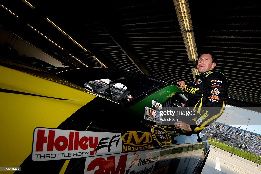 <a gi-track='captionPersonalityLinkClicked' href=/galleries/search?phrase=Carl+Edwards&family=editorial&specificpeople=193803 ng-click='$event.stopPropagation()'>Carl Edwards</a>, driver of the #99 SUBWAY Ford, gets out of his car after qualifying for the NASCAR Sprint Cup Series Coke Zero 400 at Daytona International Speedway on July 5, 2013 in Daytona Beach, Florida.