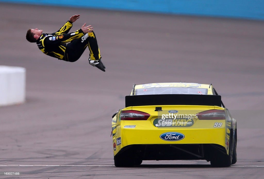 Carl Edwards, driver of the #99 Subway Ford, performs a back flip to celebrate after winning the NASCAR Sprint Cup Series Subway Fresh Fit 500 at Phoenix International Raceway on March 3, 2013 in Avondale, Arizona.