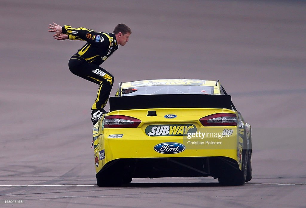 <a gi-track='captionPersonalityLinkClicked' href=/galleries/search?phrase=Carl+Edwards+-+Racecar+Driver&family=editorial&specificpeople=193803 ng-click='$event.stopPropagation()'>Carl Edwards</a>, driver of the #99 Subway Ford, performs a back flip to celebrate after winning the NASCAR Sprint Cup Series Subway Fresh Fit 500 at Phoenix International Raceway on March 3, 2013 in Avondale, Arizona.