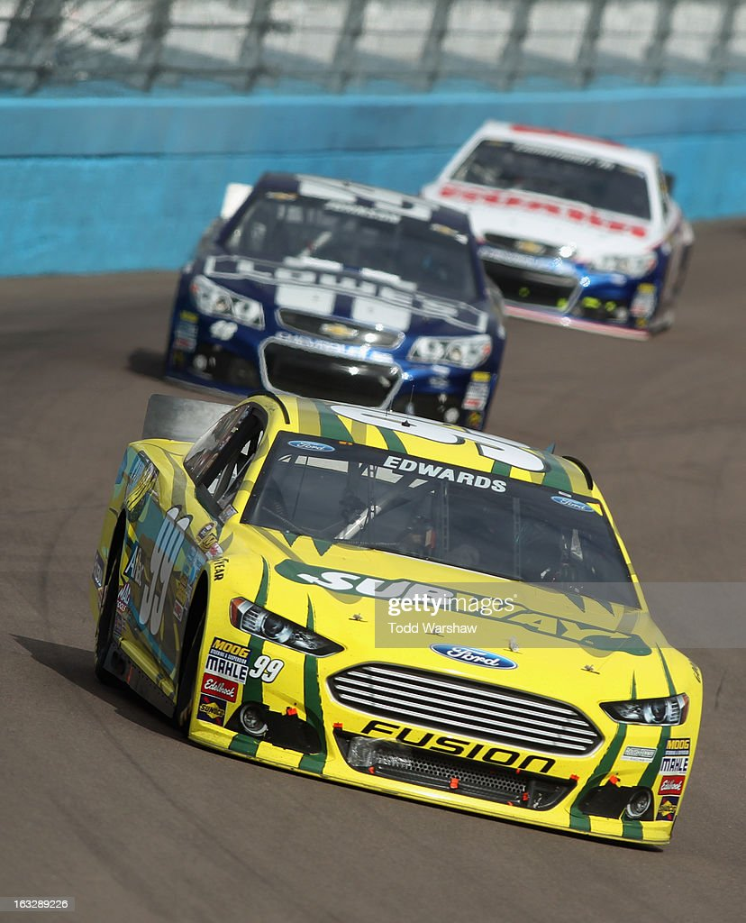 Carl Edwards driver of the Subway Ford races during the NASCAR Sprint Cup Series Subway Fresh Fit 500 at Phoenix International Raceway on March 3...