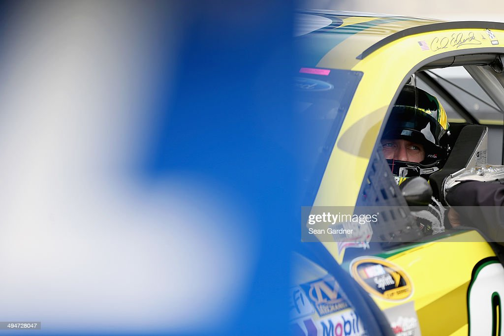 Carl Edwards, driver of the #99 Subway Ford, sits in his car during qualifying for the NASCAR Sprint Cup Series FedEx 400 Benefiting Autism Speaks at Dover International Speedway on May 30, 2014 in Dover, Delaware.