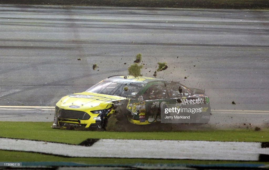 Carl Edwards, driver of the #99 SUBWAY Ford, spins through the infield after an incident during the NASCAR Sprint Cup Series Coke Zero 400 at Daytona International Speedway on July 6, 2013 in Daytona Beach, Florida.