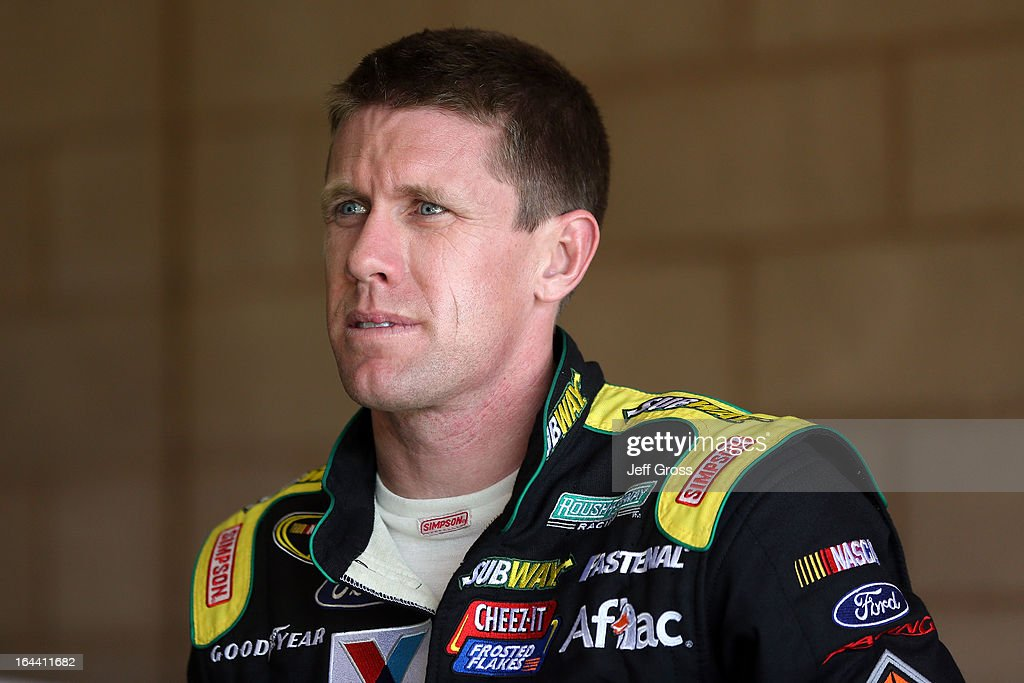 Carl Edwards, driver of the #99 Subway Ford, stands in the garage area during practice for the NASCAR Sprint Cup Series Auto Club 400 at Auto Club Speedway on March 23, 2013 in Fontana, California.