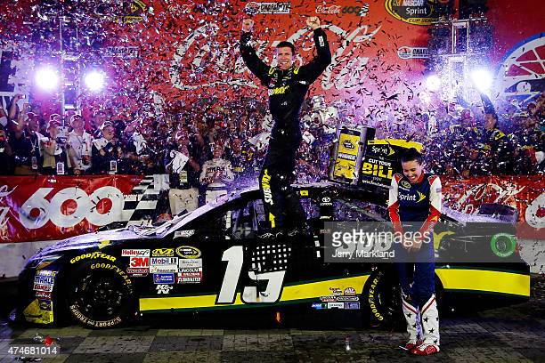 Carl Edwards driver of the Subway Toyota celebrates in Victory Lane after winning the NASCAR Sprint Cup Series CocaCola 600 at Charlotte Motor...