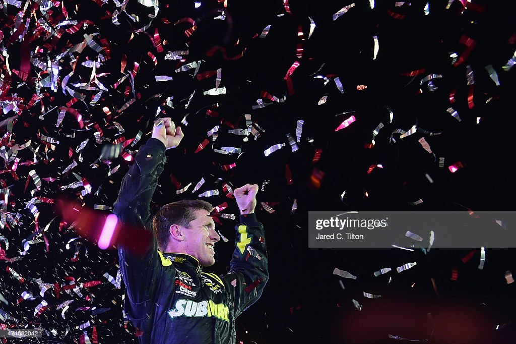 <a gi-track='captionPersonalityLinkClicked' href=/galleries/search?phrase=Carl+Edwards&family=editorial&specificpeople=193803 ng-click='$event.stopPropagation()'>Carl Edwards</a>, driver of the #19 Subway Toyota, celebrates in Victory Lane after winning the NASCAR Sprint Cup Series Coca-Cola 600 at Charlotte Motor Speedway on May 24, 2015 in Charlotte, North Carolina.