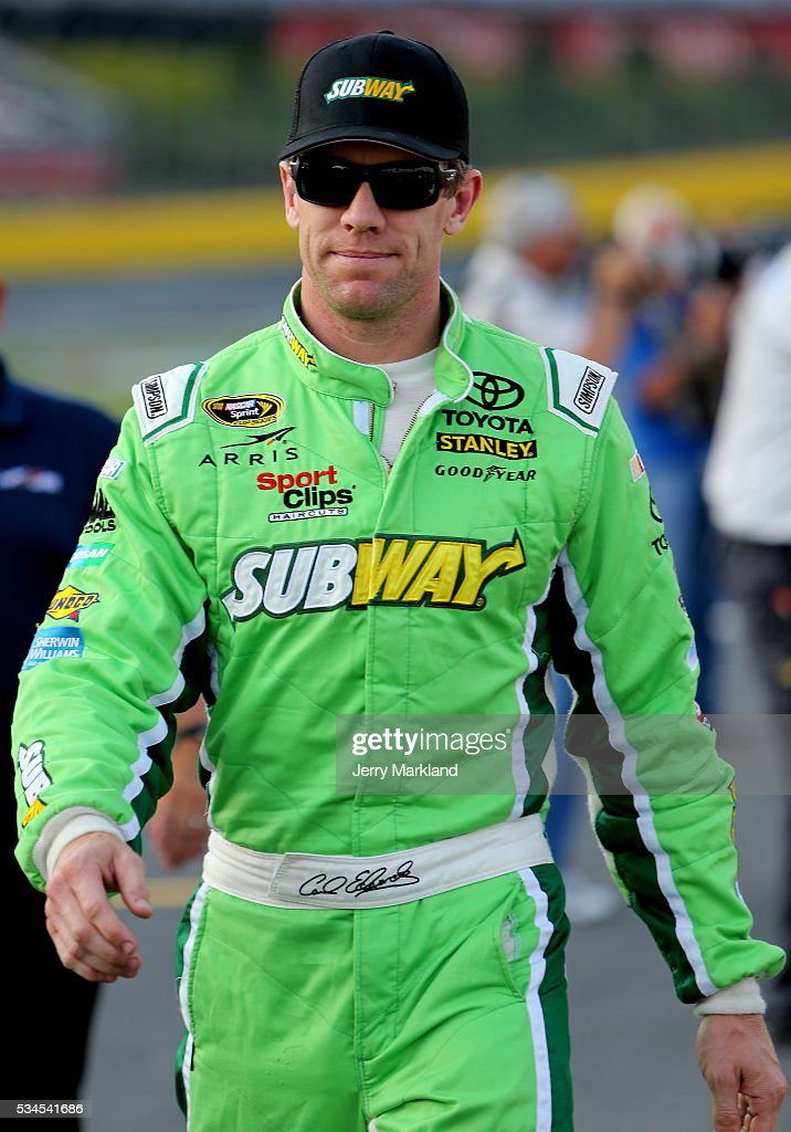 <a gi-track='captionPersonalityLinkClicked' href=/galleries/search?phrase=Carl+Edwards+-+Racecar+Driver&family=editorial&specificpeople=193803 ng-click='$event.stopPropagation()'>Carl Edwards</a>, driver of the #19 Subway Toyota, stands on the grid during qualifying for the NASCAR Sprint Cup Series Coca-Cola 600 at Charlotte Motor Speedway on May 27, 2016 in Charlotte, North Carolina.