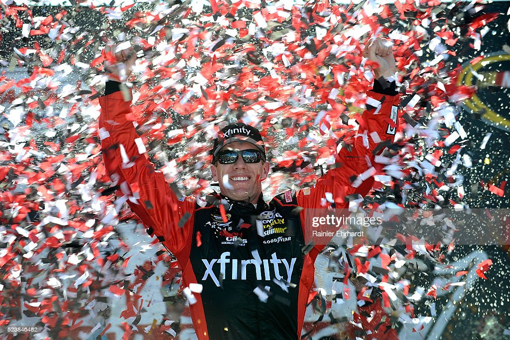 Carl Edwards, driver of the #19 XFINITY Toyota, celebrates in Victory Lane after winning the NASCAR Sprint Cup Series TOYOTA OWNERS 400 at Richmond International Raceway on April 24, 2016 in Richmond, Virginia.