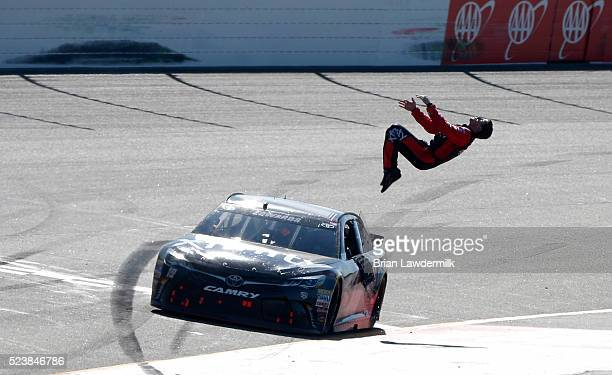 Carl Edwards driver of the XFINITY Toyota celebrates with a backflip after winning the NASCAR Sprint Cup Series TOYOTA OWNERS 400 at Richmond...