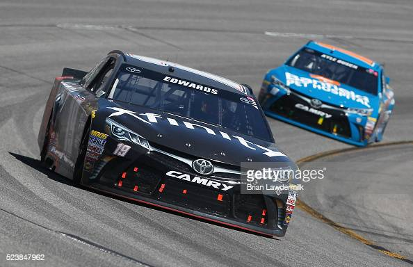 Carl Edwards driver of the XFINITY Toyota races Kyle Busch driver of the Banfield Toyota during the NASCAR Sprint Cup Series TOYOTA OWNERS 400 at...