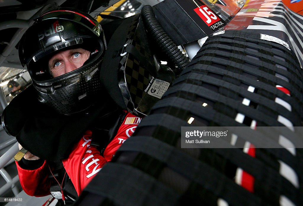 Carl Edwards, driver of the #19 Xfinity Toyota, sits in his car during practice for the NASCAR Sprint Cup Series Hollywood Casino 400 at Kansas Speedway on October 15, 2016 in Kansas City, Kansas.