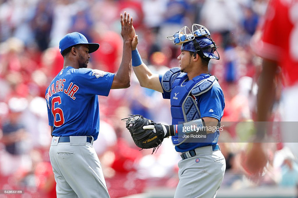 Carl Edwards Jr. #6 and Willson Contreras #40 of the Chicago Cubs celebrate after the final out of the game against the Cincinnati Reds at Great American Ball Park on June 29, 2016 in Cincinnati, Ohio. The Cubs defeated the Reds 9-2.
