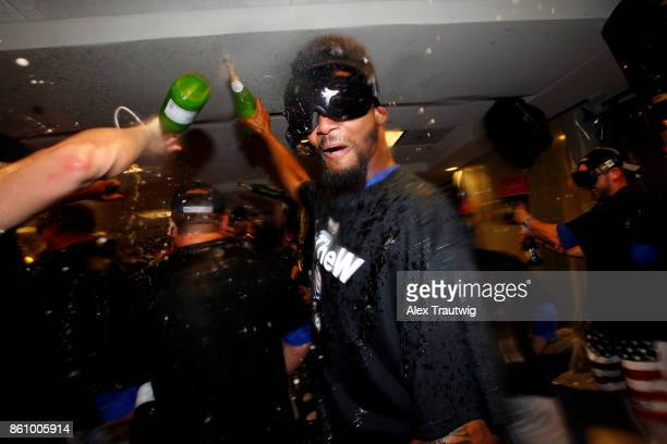 Carl Edwards Jr #6 of the Chicago Cubs celebrates with teammates in the clubhouse after winning Game 5 of the National League Division Series 98...