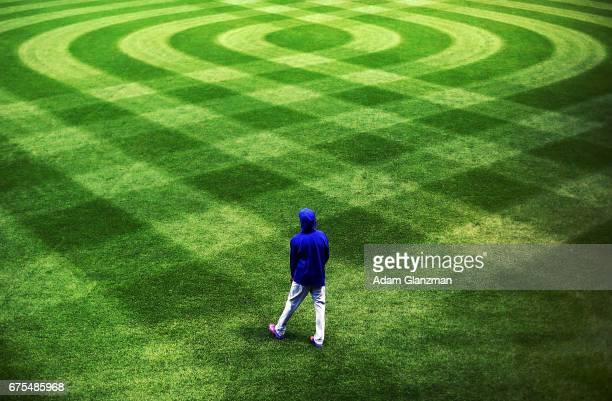 Carl Edwards Jr #6 of the Chicago Cubs warms up in center field before a game against the Boston Red Sox at Fenway Park on April 30 2017 in Boston...