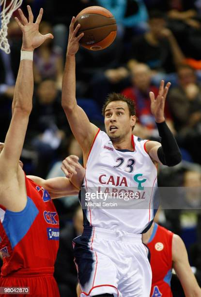 Carl English of Caja Laboral competes with Sasha Kaun of CSKA Moscow during the Euroleague Basketball 20092010 Play Off Game 2 between CSKA Moscow vs...