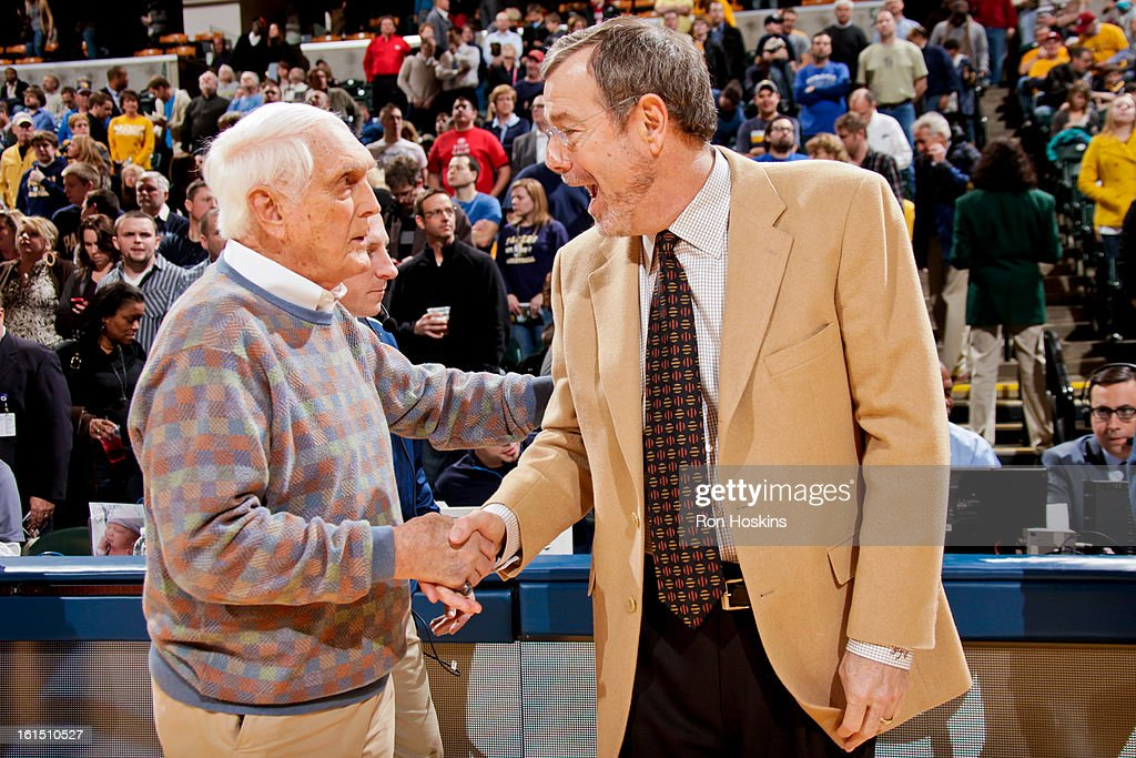 Carl Erskine, a former Brooklyn Dodgers pitcher, left, greets interim head coach P.J. Carlesimo of the Brooklyn Nets before a game between the Nets and Indiana Pacers on February 11, 2013 at Bankers Life Fieldhouse in Indianapolis, Indiana.