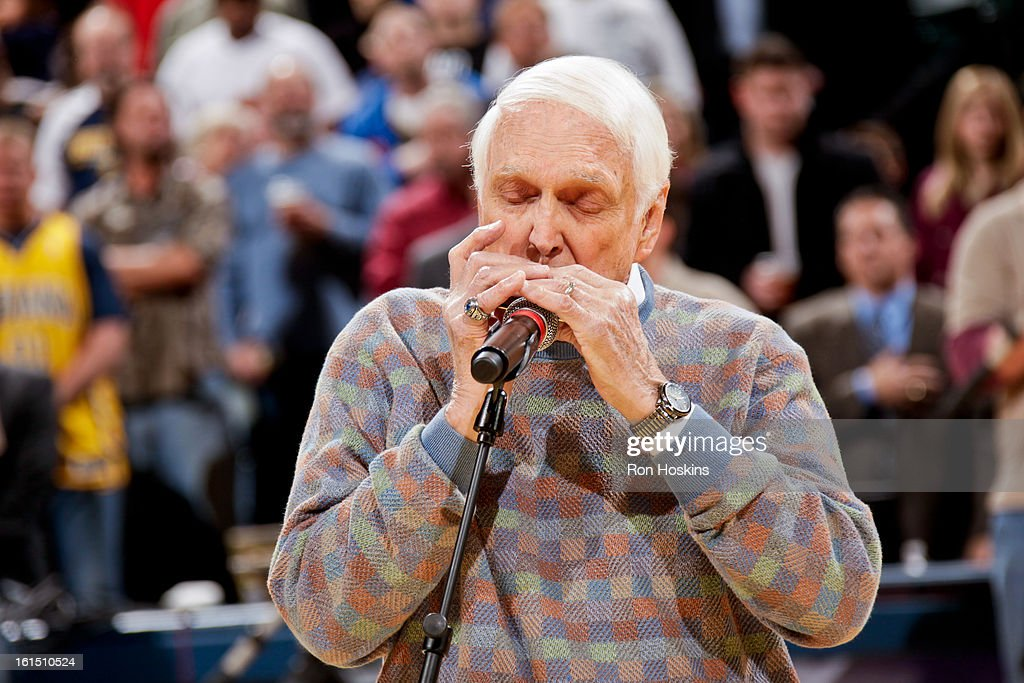 Carl Erskine, a former Brooklyn Dodgers pitcher, plays the National Anthem on his harmonica before a game between the Brooklyn Nets and Indiana Pacers on February 11, 2013 at Bankers Life Fieldhouse in Indianapolis, Indiana.