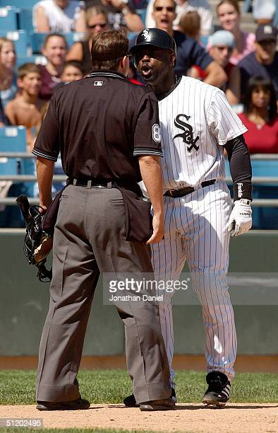 Carl Everett of the Chicago White Sox argues with home plate umpire Doug Eddings after striking out with the bases loaded in the sixth inning during...