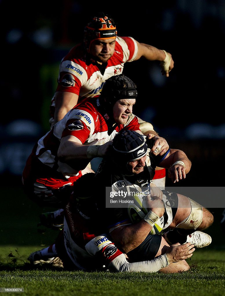 <a gi-track='captionPersonalityLinkClicked' href=/galleries/search?phrase=Carl+Fearns&family=editorial&specificpeople=4212511 ng-click='$event.stopPropagation()'>Carl Fearns</a> of Bath is tackled by Rupert Harden of Gloucester (L) during the LV= Cup match between Gloucester and Bath at the Kingsholm Stadium on February 2, 2013 in Gloucester, England.