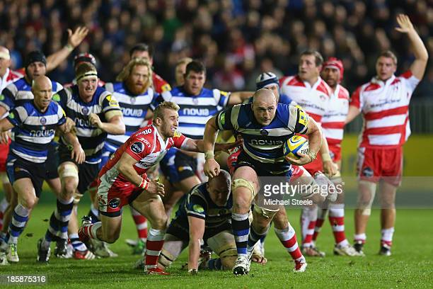 Carl Fearns of Bath makes a break as Dan Robson of Gloucester gives chase during the Aviva Premiership match between Bath and Gloucester at the...