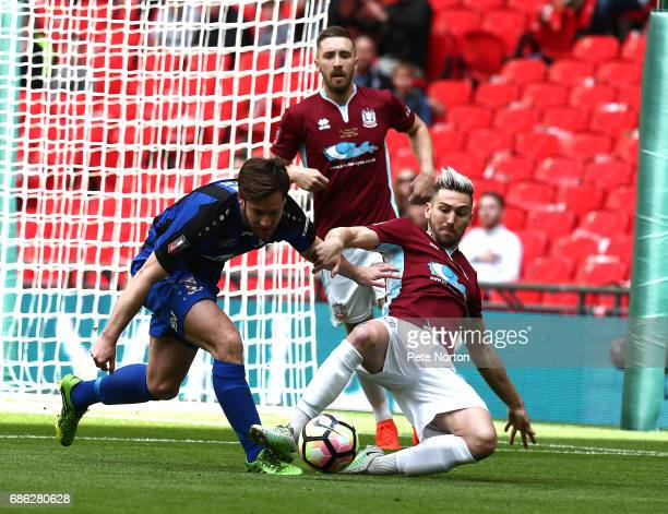 Carl Finnigan of South Shields contests the ball with Liam Dickens of Cleethorpes Town during The Buildbase FA Vase Final between South Shields and...