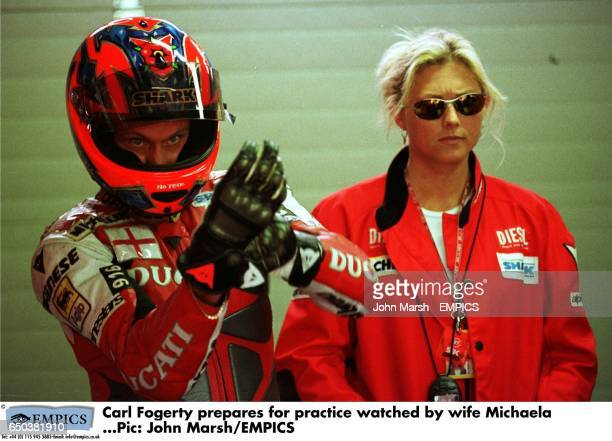 Carl Fogerty prepares for practice watched by wife Michaela Bond