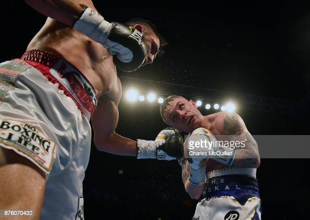 Carl Frampton and Horacio Garcia during their International Featherweight bout on the Frampton Reborn boxing bill at SSE Arena Belfast on NNNovember...