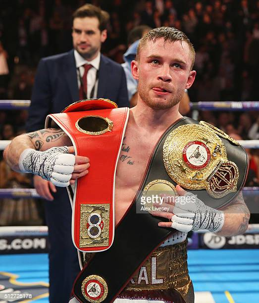 Carl Frampton celebrates with belts after a points victory over Scott Quigg after their World SuperBantamweight title contest at Manchester Arena on...