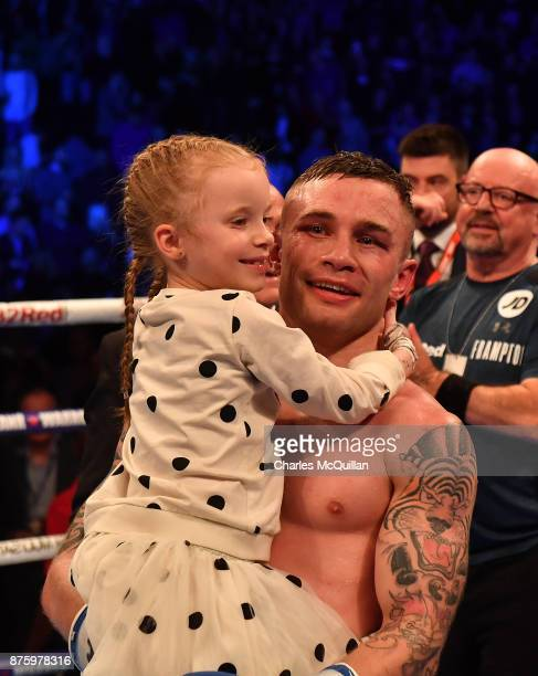 Carl Frampton celebrates with his daughter Carla after his victory over Horacio Garcia after their International Featherweight bout on the Frampton...