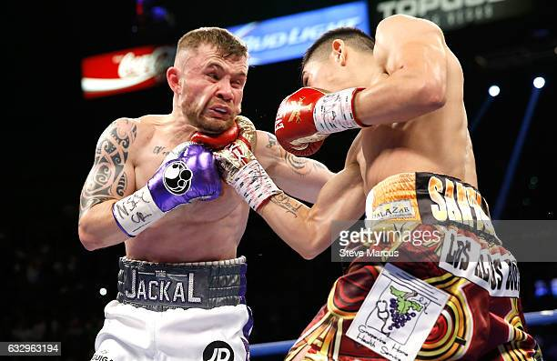 Carl Frampton gets hit by Leo Santa Cruz during their WBA featherweight title fight at MGM Grand Garden Arena on January 28 2017 in Las Vegas Nevada