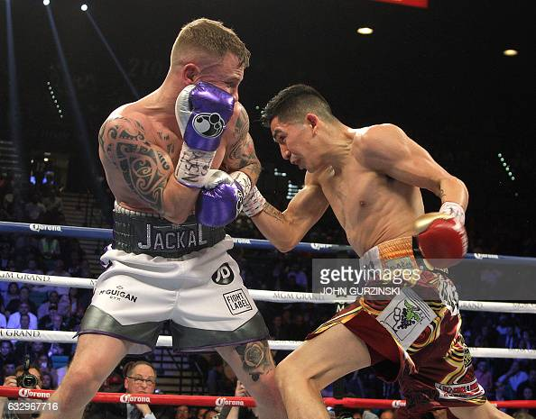 Carl Frampton IREl and Leo Santa Cruz USA during their WBC Super Featherweight title fight at the MGM Grand Arena in Las Vegas on January 28 2017...