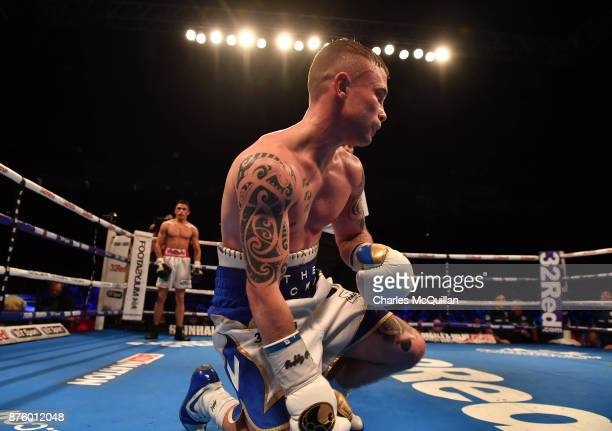 Carl Frampton is knocked down by Horacio Garcia during their International Featherweight bout on the Frampton Reborn boxing bill at SSE Arena Belfast...