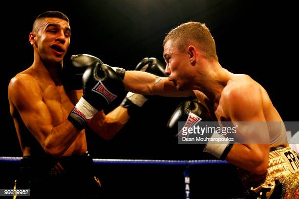 Carl Frampton of Belfast lands a punch on Yohan Boyeaux in their SuperBantamweight bout at York Hall on February 12 2010 in London England