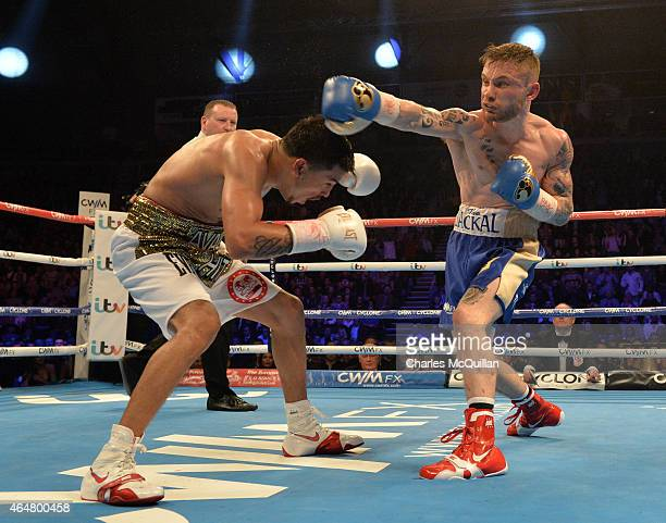 Carl Frampton of Northern Ireland battles Chris Avalos of USA for the IBF Super Bantamweight World Title at Odyssey Arena on February 28 2015 in...