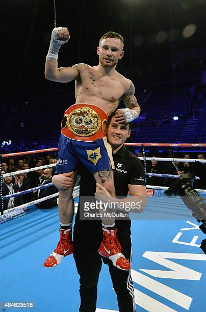Carl Frampton of Northern Ireland celebrates with trainer Shane McGuigan after his victory over Chris Avalos of USA for the IBF Super Bantamweight...