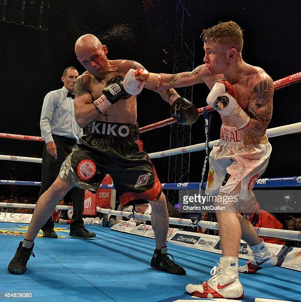 Carl Frampton of Northern Ireland lands a punch during the IBF superbantamweight world title bout against world champion Kiko Martinez of Spain at...