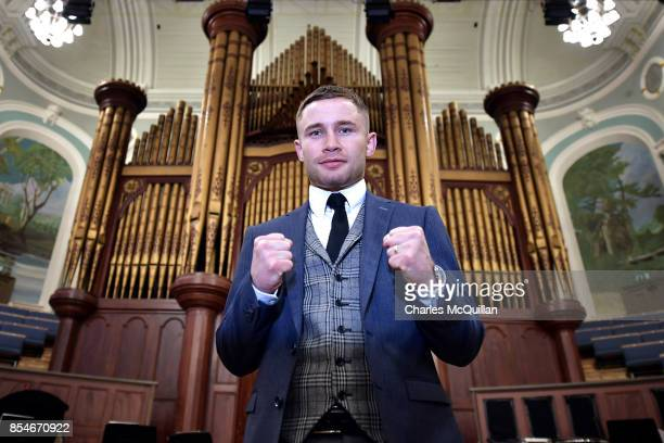 Carl Frampton poses for photographers in front of the famous Ulster Hall organ as he attends a press conference to announce details of his...