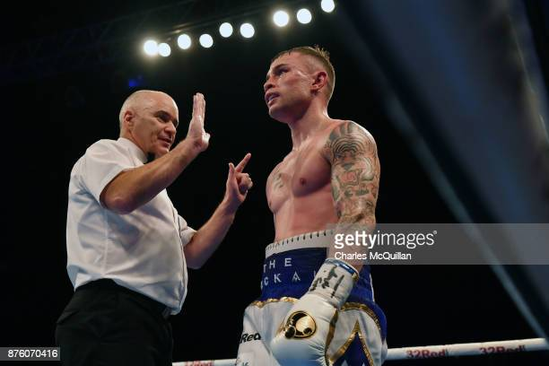 Carl Frampton takes a standing count during his International Featherweight bout with Horacio Garcia on the Frampton Reborn boxing bill at SSE Arena...