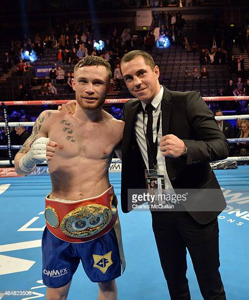 Carl Frampton with Scott Quigg aftet Framptons victory for the IBF Super Bantamweight World Title at Odyssey Arena on February 28 2015 in Belfast...