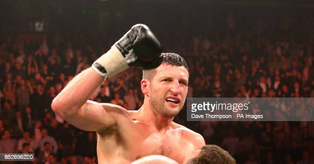 Carl Froch celebrates after defeating George Groves with a ninth round stoppage during the WBA and IBF Super Middleweight Title fight at the Phones...