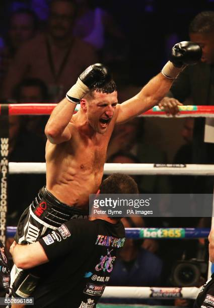 Carl Froch celebrates following a ninth round stoppage in his WBA and IBF Super Middleweight Title fight against George Groves at the Phones 4u Arena...