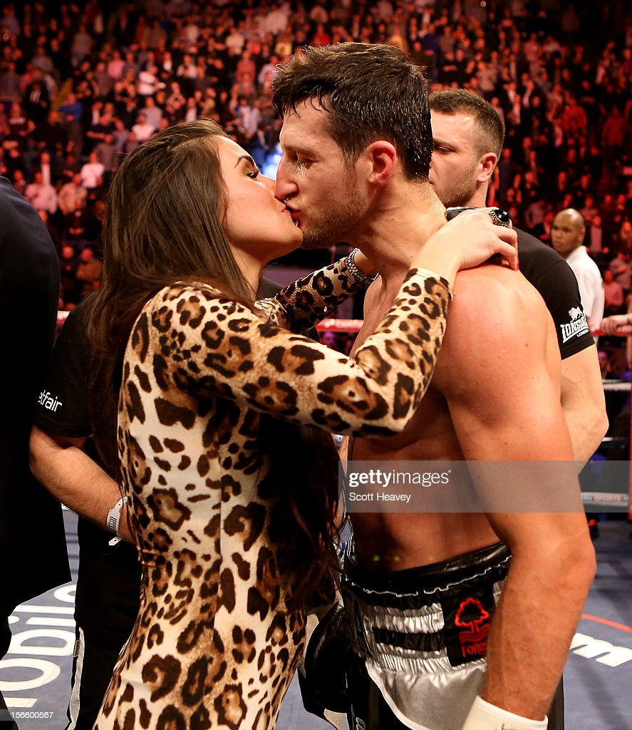 <a gi-track='captionPersonalityLinkClicked' href=/galleries/search?phrase=Carl+Froch&family=editorial&specificpeople=241345 ng-click='$event.stopPropagation()'>Carl Froch</a> celebrates with girlfriend Rachel Cordingly after beating Yusaf Mack during their IBF World Super Middleweight Title Fight at Nottingham Capital FM Arena on November 17, 2012 in Nottingham, England.