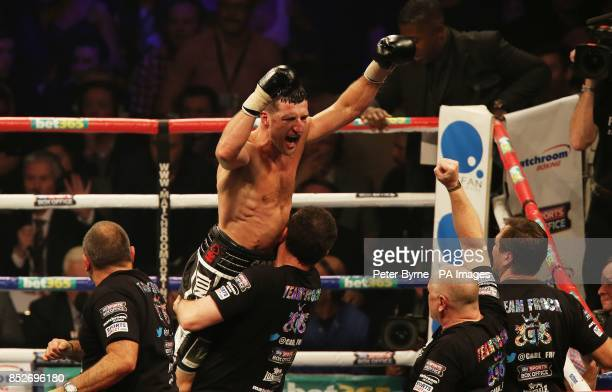 Carl Froch celebrates with his corner following a ninth round stoppage in his WBA and IBF Super Middleweight Title fight against George Groves at the...