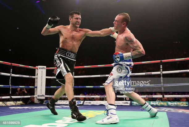 Carl Froch connects with George Groves during their IBF and WBA World Super Middleweight bout at Phones4u Arena on November 23 2013 in Manchester...