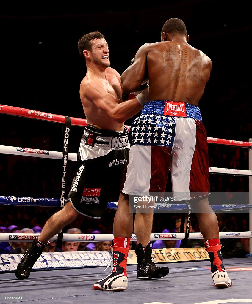 <a gi-track='captionPersonalityLinkClicked' href=/galleries/search?phrase=Carl+Froch&family=editorial&specificpeople=241345 ng-click='$event.stopPropagation()'>Carl Froch</a> (L) in action with Yusaf Mack during their IBF World Super Middleweight Title Fight at Nottingham Capital FM Arena on November 17, 2012 in Nottingham, England.