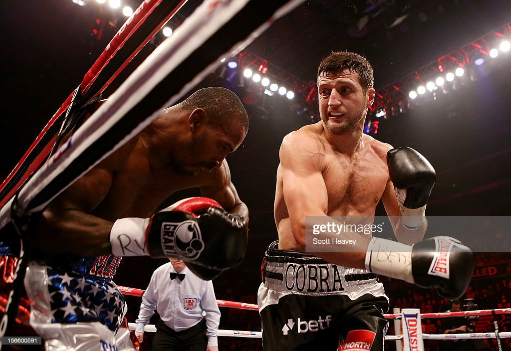 Carl Froch (R) in action with Yusaf Mack during their IBF World Super Middleweight Title Fight at Nottingham Capital FM Arena on November 17, 2012 in Nottingham, England.